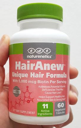 Image of a bottle of HairAnew being held in my hand