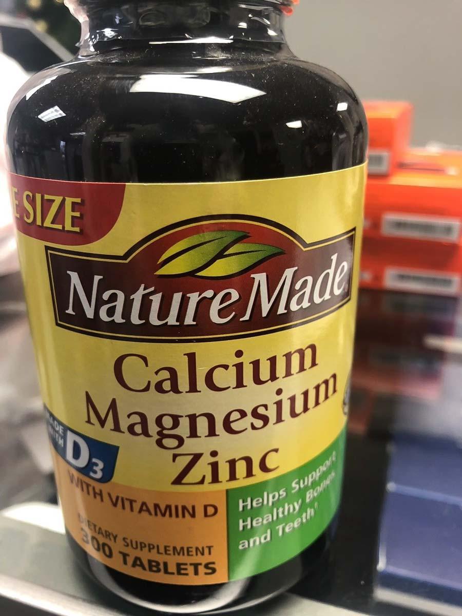 Image of a bottle of the best calcium magnesium supplement, NatureMade Calcium Magnesium & Zinc with Vitamin D3
