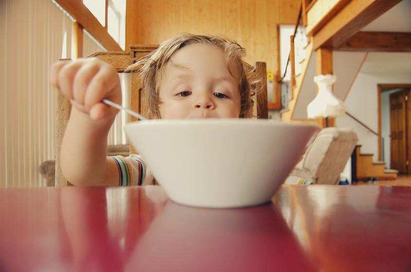 Image of a child eating cereal