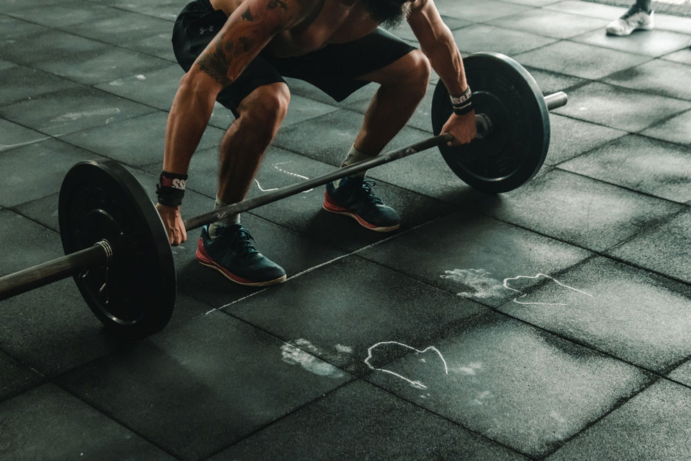 Image of a man doing a workout by lifting weights