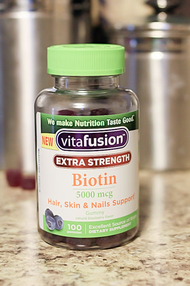 Image of a bottle of Vitafusion Extra Strength Biotin on a granite counter top
