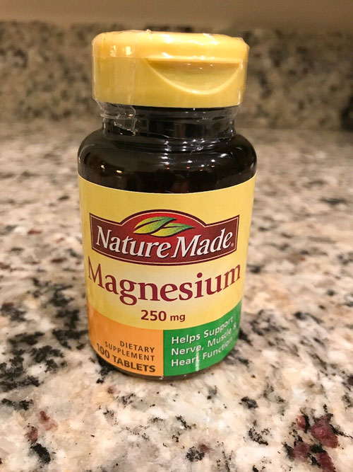 Image of a bottle of Nature Made 250 mg Magnesium Tablets on a granite counter top