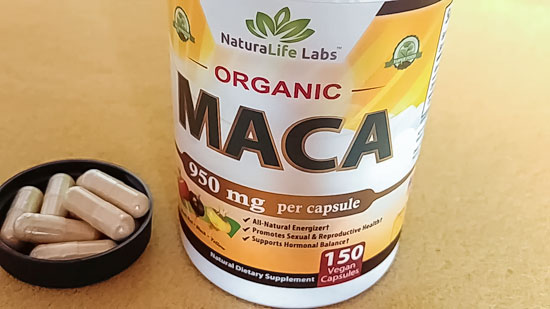 Image of a bottle of NutraLife Labs Organic Maca with some pills in the bottle cap to the side
